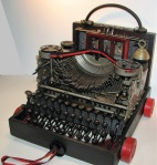 """Portable Typewriter.    Three dimensional assemblage.  12"""" x 12"""" x 12.75"""".   (#1352)  Scroll down for description."""