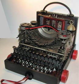 "Portable Typewriter. Three dimensional assemblage seen in Arabella Magazine. 12"" x 12"" x 12.75"". (#1352) Scroll down for description."