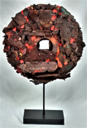 "Rusty Disk. SOLD. 3-dimensional assemblage. 14"" x 21.5"" x 3.5"" (#1409)."
